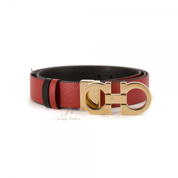 SALVATORE FERRAGAMO ADJUSTABLE AND REVERSIBLE GANCINI BELT IN LIPSTICK/BLACK